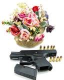 Handgun pistol and flower on white background Stock Photos
