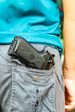 Handgun in pocket Royalty Free Stock Photography