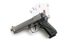 Handgun and poker cards Stock Images