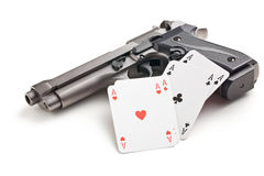 Handgun and poker cards Royalty Free Stock Image