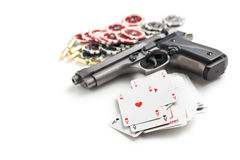 Handgun and poker cards royalty free stock photography