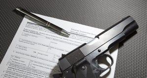 Handgun purchase paperwork Royalty Free Stock Photo
