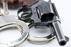 Handgun revolver and police handcuff with bullets Royalty Free Stock Images