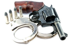 Handgun revolver and police handcuff with bullets Stock Photography