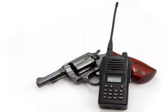 Handgun revolver and Police Radio communication Royalty Free Stock Photography