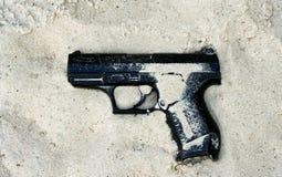 Handgun in sand Royalty Free Stock Image