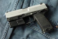 Handgun, semi-automatic. Semi-automatic handgun on carpet background, 9mm pistol Stock Image