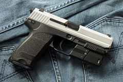Handgun, semi-automatic. Semi-automatic handgun on carpet background, 9mm pistol Stock Photo