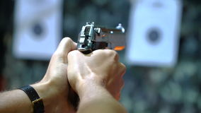 Handgun shooting at a shooting range stock video footage