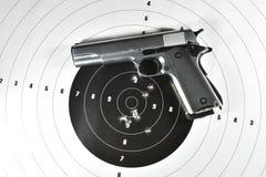 Handgun and shooting target. M1911 .45 semi automatic handgun and shooting target Stock Images