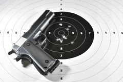 Handgun and shooting target. Handgun and shooting practice target Royalty Free Stock Photos