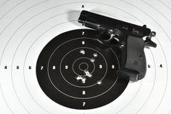 Handgun and shooting target. Handgun and shooting practice target Stock Images