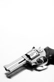 Handgun on steel surface Stock Photo