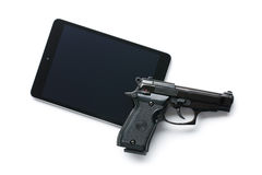 Handgun and tablet Royalty Free Stock Photos