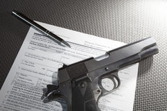 Handgun transfer paperwork Royalty Free Stock Photo