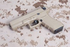 Handgun on uniform. 9mm handgun on camouflage uniform Stock Images