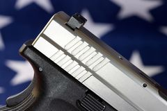 Handgun with United States flag - The Right to Bear Arms Stock Photography
