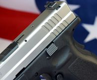 Handgun with United States flag - The Right to Bear Arms Royalty Free Stock Image