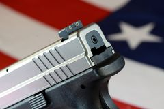 Handgun with United States flag - The Right to Bear Arms Stock Photos