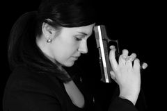 Handgun. Woman with handgun in black and white stock photos