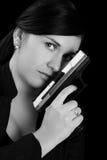 Handgun. Woman with handgun in black and white stock photography