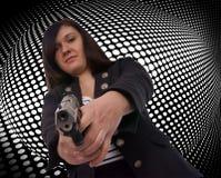Handgun. Woman with handgun with grid background stock photography