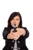 Handgun. Woman with handgun over a white background royalty free stock photography