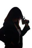 Handgun. Woman with handgun over a white background royalty free stock photo