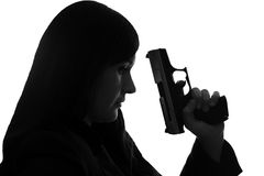 Handgun. Woman with handgun over a white background royalty free stock photos