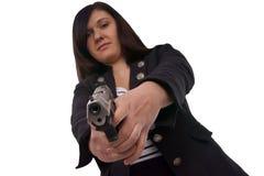 Handgun. Woman with handgun over a white background stock photo