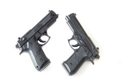 Handguns. A top view photo taken on two automatic toy pistols Stock Images