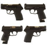 Handguns. Isolated on white background depicting a black 9mm kel-Tec PF-9 pistol and a Kahr Arms PM9 9mm pistol Royalty Free Stock Images