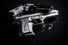 Handguns on black background Stock Photography