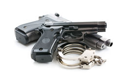 Handguns and handcuffs Royalty Free Stock Photography