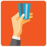 Handhållkreditkort som betalar Arkivbild