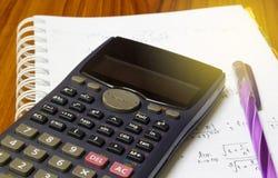 Handheld calculator on a sheet of paper. Maths concept - handheld calculator on a sheet of paper with maths-formulas Stock Photos