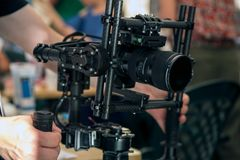 Handheld camera gimbal. For DSLR video and photography Stock Photography