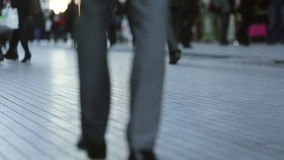 Handheld close up of feet of busy business commuters stock video