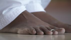 Feet With Toe Ring. Handheld, close up shot of bare feet, a toe ring is on the index toe stock footage