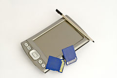 Handheld computer with sd rams. Palm size computer with stylus and blue sd card Royalty Free Stock Images