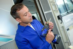 Handheld driller and drill. Man Royalty Free Stock Images