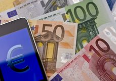 Handheld with euro sign -two-. Handheld with euro sign on european banknotes Royalty Free Stock Images
