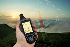 Handheld GPS. Device displaying topographical map with marked current position Stock Image