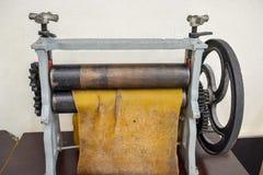 Handheld läderdelare arkivbild
