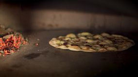 Pan shot of vegetarian pizza cooking baking in the oven stock footage