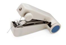 Handheld  sewing machine Royalty Free Stock Photos