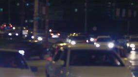Handheld shaking shot of blurred urban traffic stock video