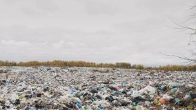 Сity garbage dump, environmental pollution due to lack of recycling technology stock video footage