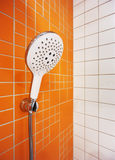 Handheld shower head In bathroom Royalty Free Stock Image