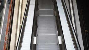 Handheld of an empty escalator in the Berlin Central Station. Handheld top view of an empty escalator in the Berlin Central Station. Real time shot stock footage